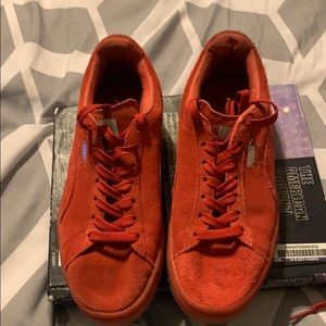 Red Suede pumas with extra laces